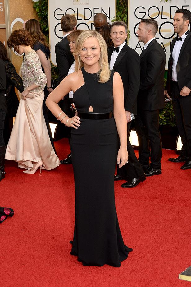 "<strong>Amy Poehler in Stella McCartney</strong><br> After donning this sleek gown, consider Poehler a member of McCartney's A-list army. The comedian and co-host chose a Stella suit for last year's awards and has become a front row regular at the designer's shows. McCartney's official Instagram even shared a snap of the blonde, pre-show, with the caption, ""I love you Amy! Golden Globes Girl! X"""