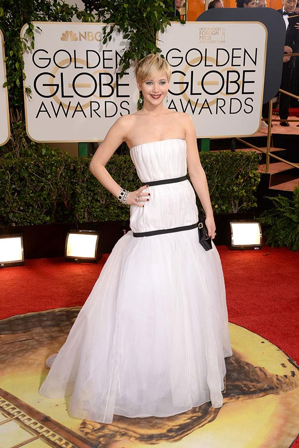 <strong>Jennifer Lawrence in Dior Couture <br></strong> Miss Dior herself wore a strapless monochrome Christian Dior Couture gown to accept her Best Supporting Acrtess award. As the face of the French brand, Lawrence sarcastically quipped that she was aiming to 'shock' when she chose the gown from Raf Simons' winter 2013 collection.