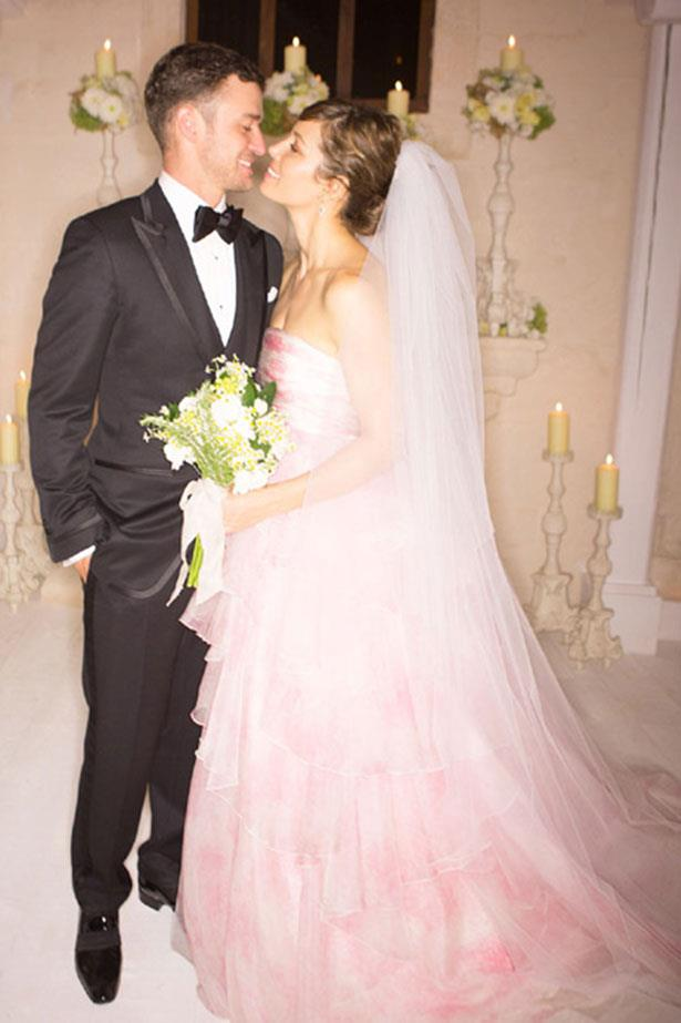 "**Jessica Biel**<br><br> It felt like Jess's 2012 wedding to Justin Timberlake was a long time coming, so she had plenty of time to decide on her gown. Her choice: a blush-coloured Giambattista Valli creation. ""I wanted the dress to be very romantic and feminine and a shape that I very rarely wear,"" she said. ""I have never been crazy about all-white wedding dresses, for me at least.""</p>"