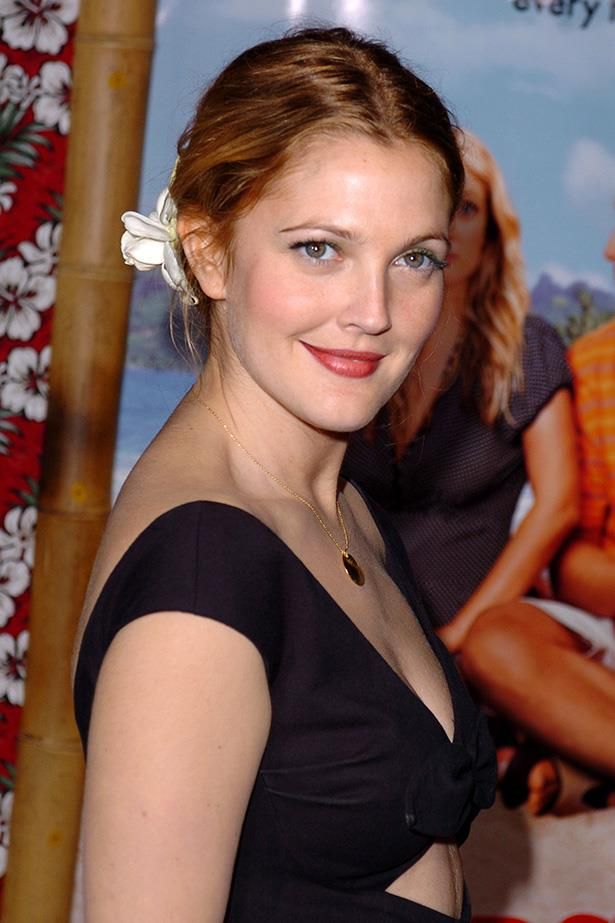 Sweet and pretty at the 50 First Dates premiere in 2004, the actress had gone back to her auburn roots with a simple chignon, complete with a flower.