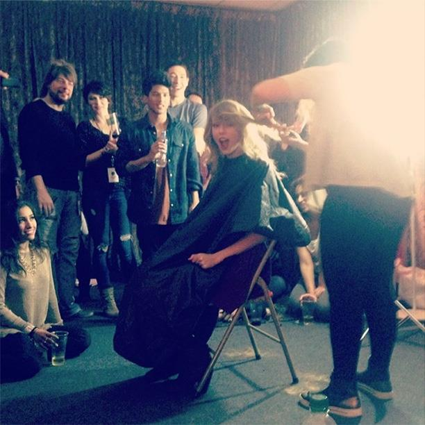 "Cara Delevingne was there to witness the snip, ""@taylorswift chopping off her locks ✂."""