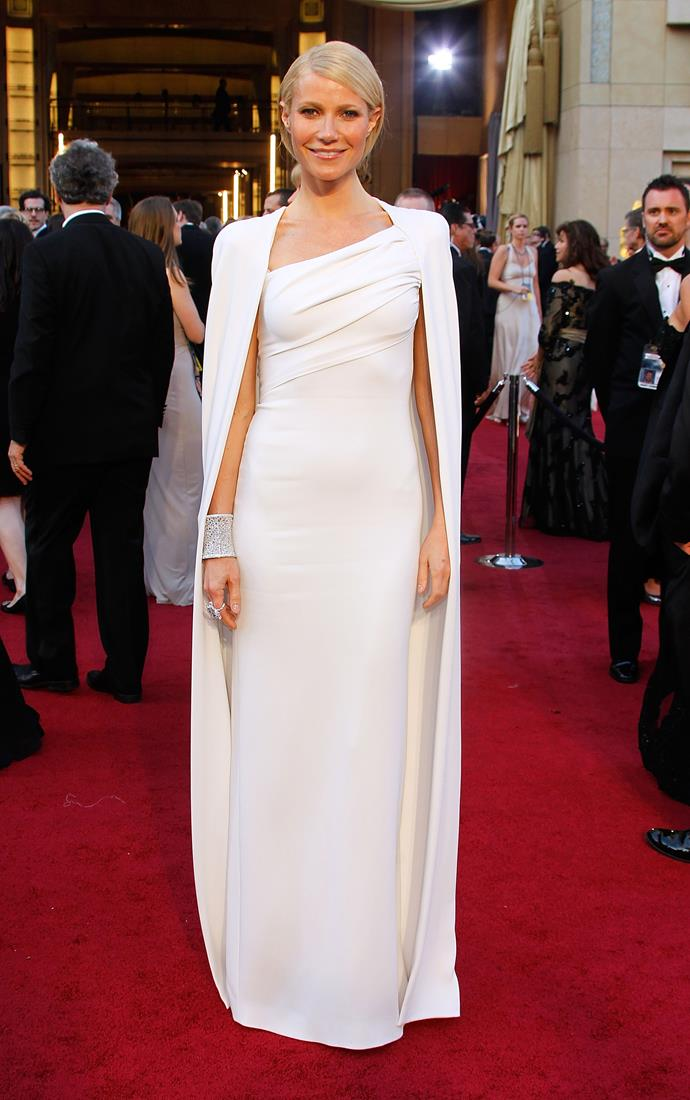 <strong>Gwyneth Paltrow, 2012</strong><br></br> Up until this point, Gwyn had had some highs and lows with her awards season outfit choices (the pink Ralph Lauren number in 1999 certainly divided opinions), but there was no arguing her success in 2012. Her white Tom Ford gown with matching long cape was sleek and simple, and a definite standout on the night.