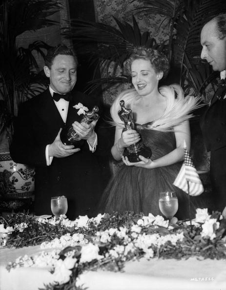<strong>Bette Davis, 1939</strong><br></br> On the night she won a Best Actress award for <em>Jezebel</em>, Bette donned a glam black tulle dress with an attention-grabbing gossamer collar that resembled a wreath of white feathers.