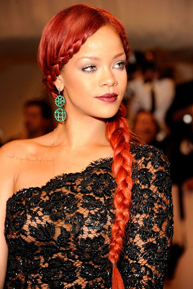 Rihanna kept the vibrant hair colour for the 2011 MET costume gala, enlisting hair extensions to create a Rapunzel plait for the evening.