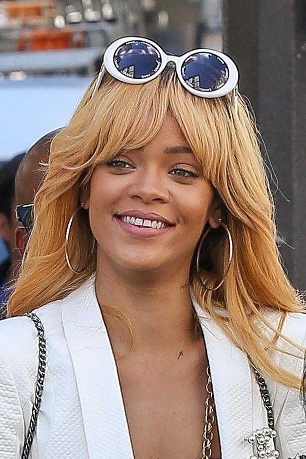 Back to blonde, Rihanna visited in Paris mid-2013 with a fringe and soft Farrah-flicks.