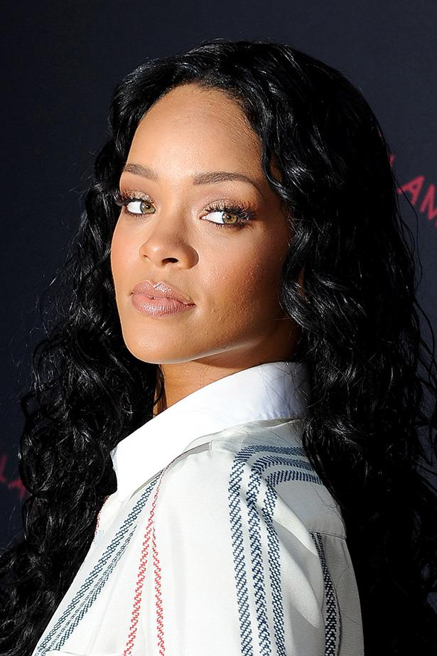 Re-inventing her look yet again, Rihanna went back to her long-hair beginnings at a M.A.C pre-Grammy party.