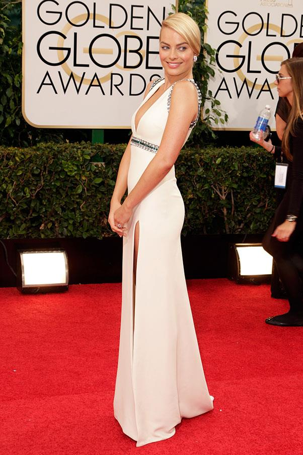 At the Golden Globes, she went back to stunning white, in Gucci, this time with a bejellewed trim to add sparkle.