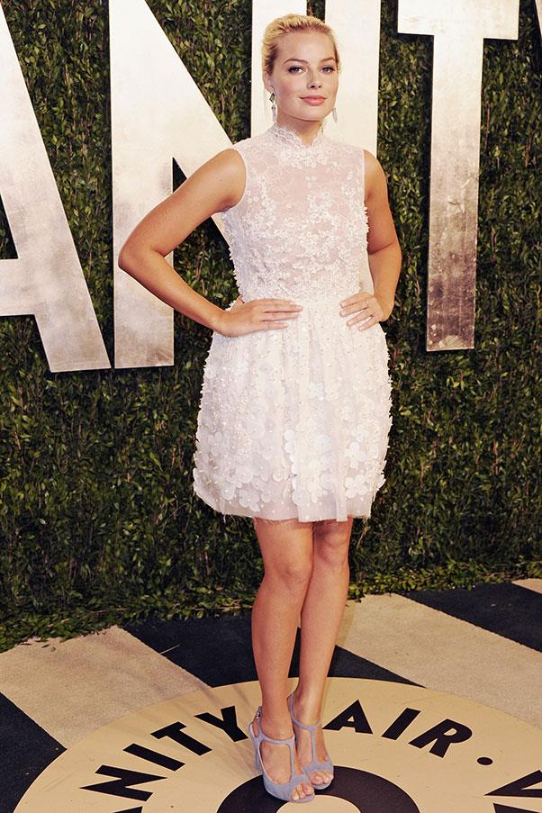 At Vanity Fair's Oscars Party in 2013, when her work with Scorsese was just a twinkle in her eye, Robbie pulled on a short white Georges Hobeika Atelier cocktail frock.