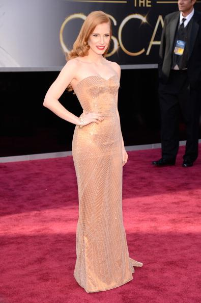 Jessica Chastain at the 85th Academy Awards, 2013, wearing Armani Privé and Harry Winston jewellery. Sh was nominated for Best Actress for <em>Zero Dark Thirty </em>