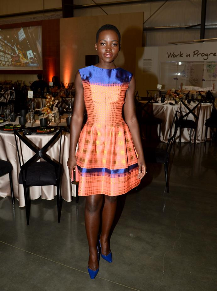 Lupita Nyong'o wearing Vivienne Westwood at a Q&A session with His Holiness the 14th Dalai Lama and Ann Curry
