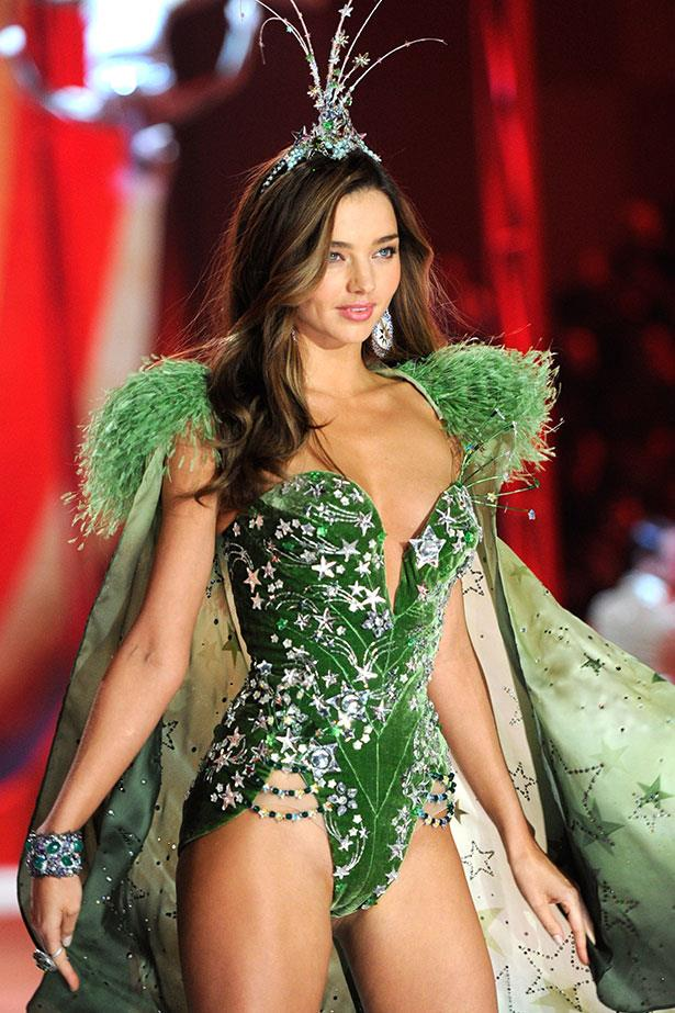Looking like a sexy poison ivy, Miranda Kerr does a one-piece for Victoria's Secret in 2012