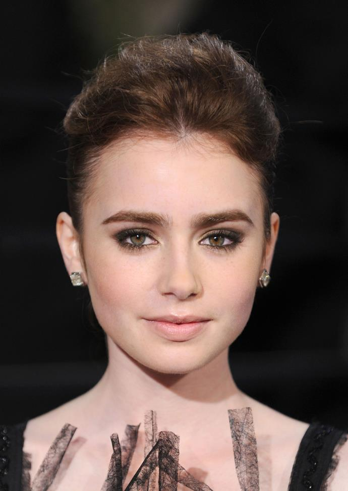 A voluminous up-do and black smoky eyeshadow was the perfect accompaniment to the actress' dramatic black dress at the 2010 Vanity Fair Oscars Party.
