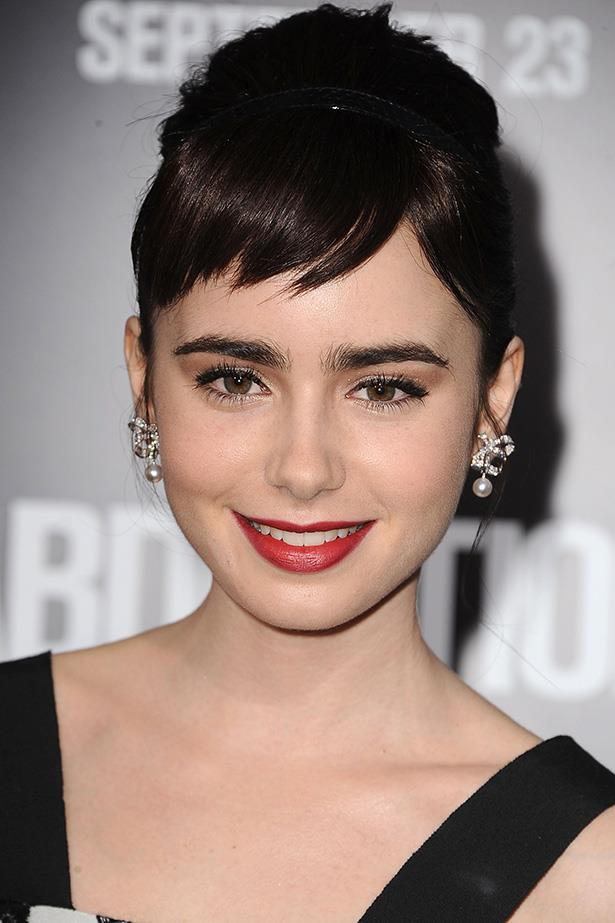 Paying homage to Audrey Hepburn, Collins walked the red carpet premiere of her 2011 film, Abduction. Her short, boyish fringe is softened by her feminine cat's eye liquid-liner, and deep red lip.