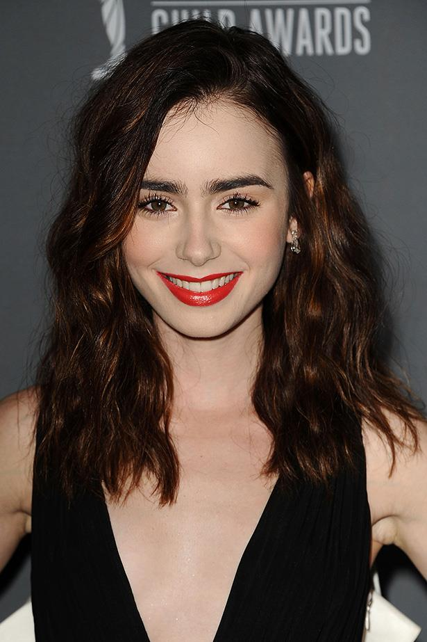 Bright red lipstick highlighted the copper colours in the actress' hair, which was styled in loose waves at an event in 2012.