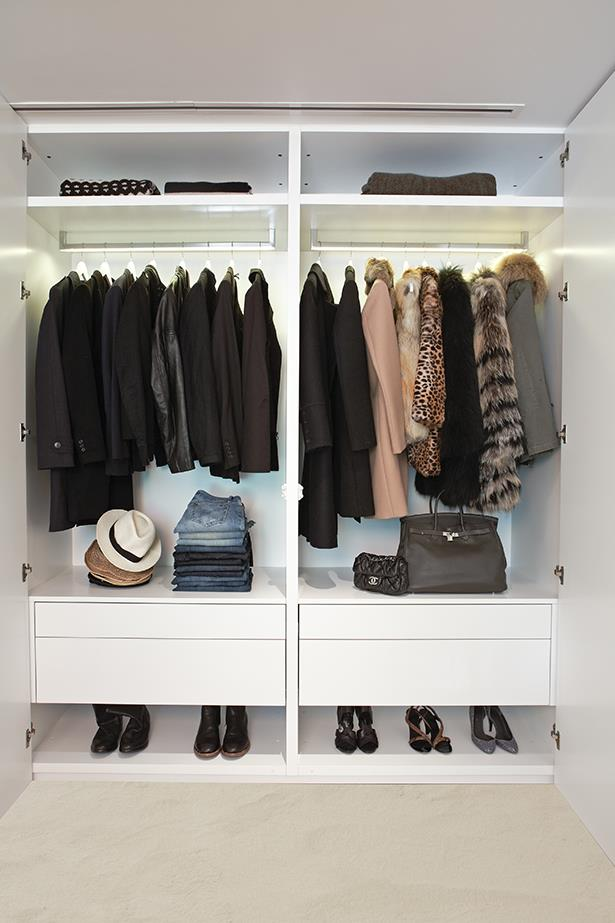 """<strong>Turn your closet into a shop</strong><br><br> """"There's a reason why shopping in beautiful stores is such a nice experience. Having pull-out valet hooks in your closet to hang various outfits on will enable you to arrange your clothes much like merchandising a shop. Make sure you have adequate lighting in your closet, especially in your hanging areas, so you can see everything you own and tell black from navy.  I would recommend lighted hanging rods. Custom drawer inserts help everything in your drawers to stay organised, so you know where everything is at first glance, and can put things back accordingly. Add a mirror in your closet so you can quickly see how the outfit looks before moving on to the next! Design and organise your closet so there is flow based on your lifestyle, how you get dressed, etc."""""""