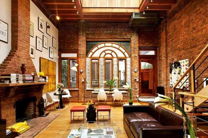 The main hall boasting 25-foot ceilings and a working fireplace.