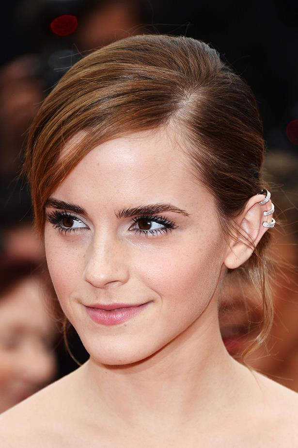 Emma Watson goes minimal with her ear jewellery, pairing it with a side-swept fringe and fresh makeup.