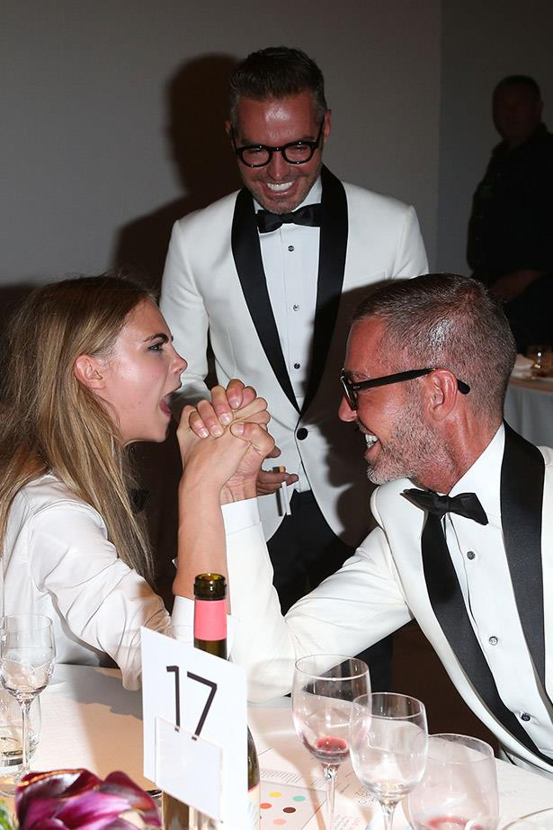 Cara Delevigne challenges D'Squared's Dean and Dan Caten to an arm wrestle competition.