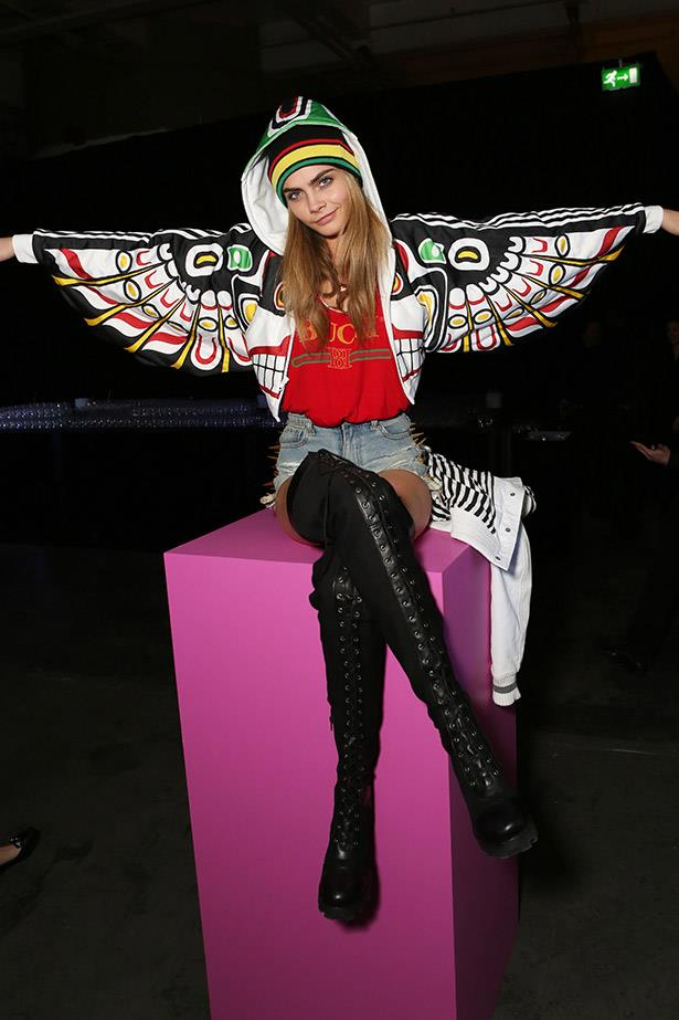 Cara Delevigne speads her wings.