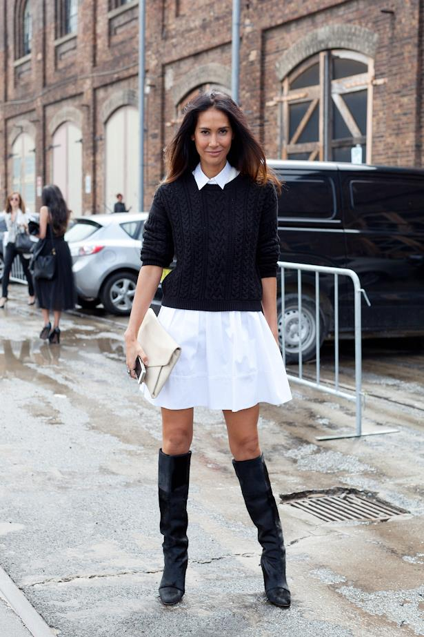 Model turned cosmetics entrepreneur Lindy Klim goes monochrome in a white shirt dress with thigh high boots and white Givenchy clunch
