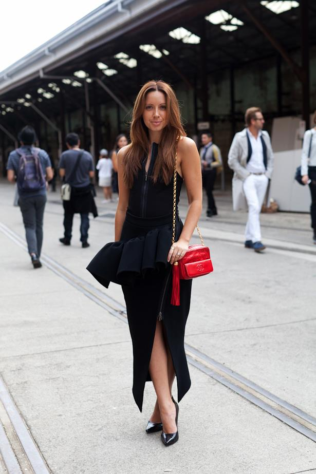 Proving that the peplum trend is still strong in 2014, this attendee wears hers with a vintage Chanel chain bag