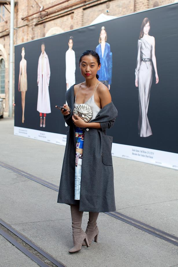 Margaret Zhang wears Topshop cami, Clover Canyon skirt with Love and Objects bag and Stuart Wiseman boots.