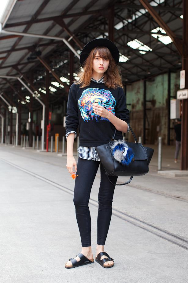 Gabby Dover wears Vintage hat and shirt, Christopher Kane sweater, Fendi key chain and Celine bag.