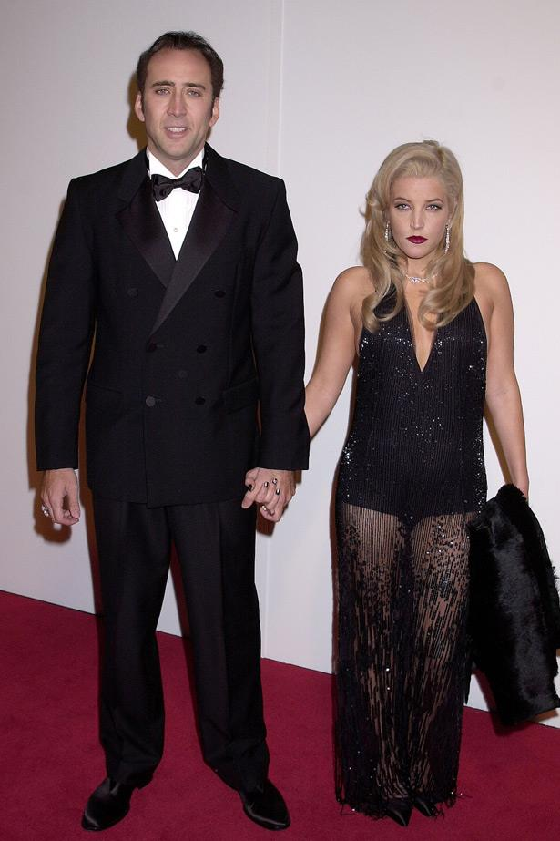 It doesn't take a relationship expert to recognise the body language in this photo as seriously awkward. After she split from Michael Jackson, Lisa Marie Presley went on to marry Nicolas Cage in 2002. They divorced just three months later.
