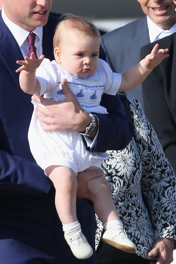 Prince George gives the official rock n roll private jet wave.
