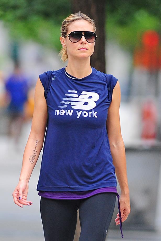 Heidi Klum looks zen wearing a New Balance tee which also matches her nail polish – bonus beauty points.