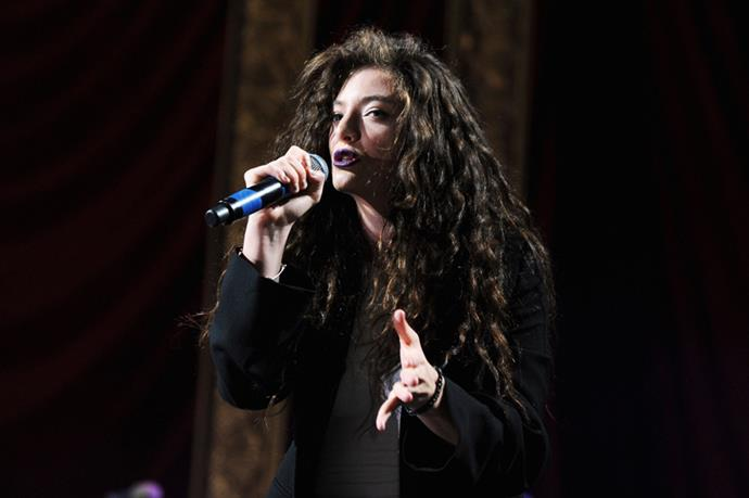 """<strong>Lorde</strong> <br><br> Lorde – whose real name is Ella Marija Lani Yelich-O'Connor – opted for a more tailored ensemble for week two, teaming a dark trouser suit and blazer with white high tops and her trademark purple lipstick. Opening with """"Glory And Gore"""", she told the crowd she's """"not ready to grow up"""" before leading them in a rendition of """"Royals""""; confetti canons capped off a performance that was far from sedate."""