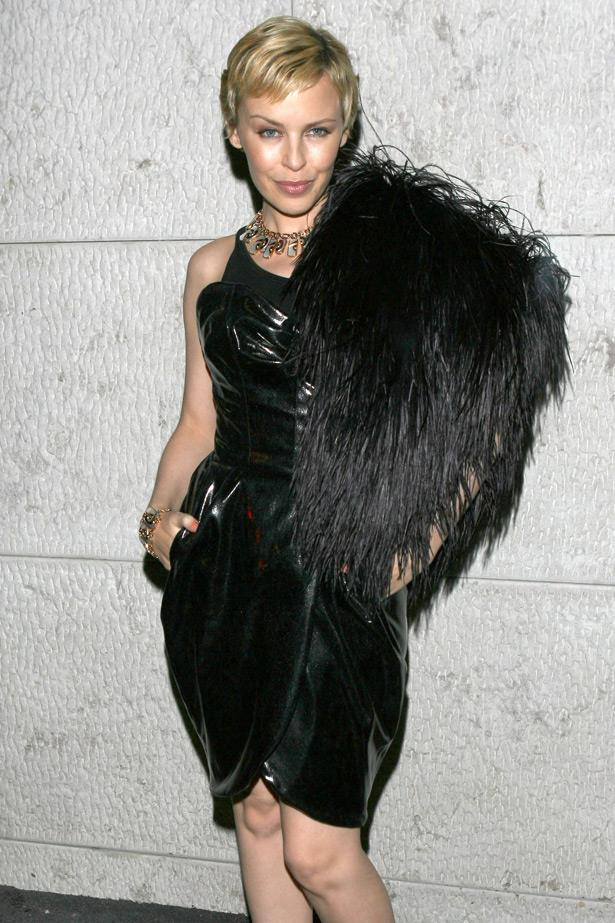 Gamine chic: Kylie recovers from breast cancer and embraces her post-chemo cropped hair in 2006.