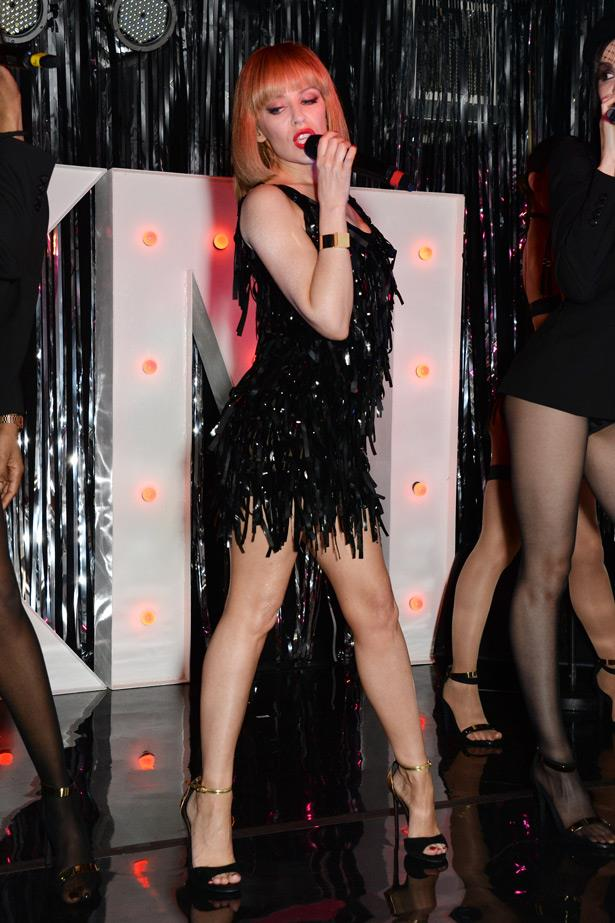 In celebration of her latest album, <em>Kiss Me Once</em>, Kylie took over a small pub in London and her love of fringed costumes reappears.