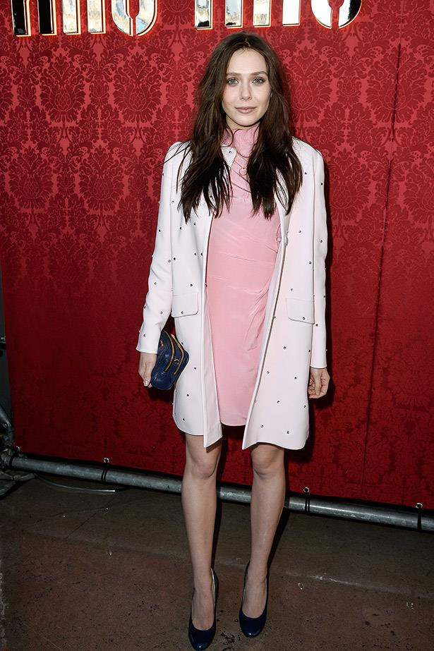 Elizabeth Olsen hits Paris fashion week to sit front row at Miu Miu, looking very pretty in a pink jacket and dress by the Italian label. She's also just been announced as the face of the brand, alongside Lupita Nyong'o, Elle Fanning, and Bella Heathcote.