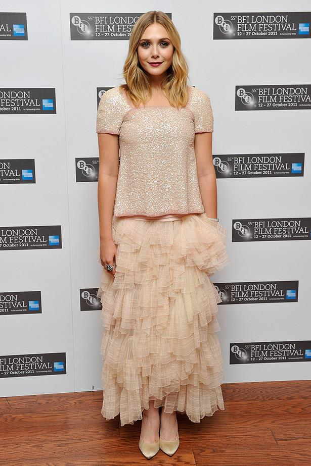 At the London premiere of <em>Martha Marcy May Marlene</em>, Elizabeth Olsen divine in this Chanel Couture down and Christian Louboutin shoes.
