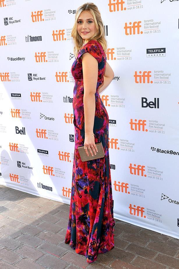 Elizabeth Olsen in a beautiful floral Erdem dress and Ferragamo clutch at the Toronto film festival for her breakout film <em>Martha Marcy May Marlene.</em>