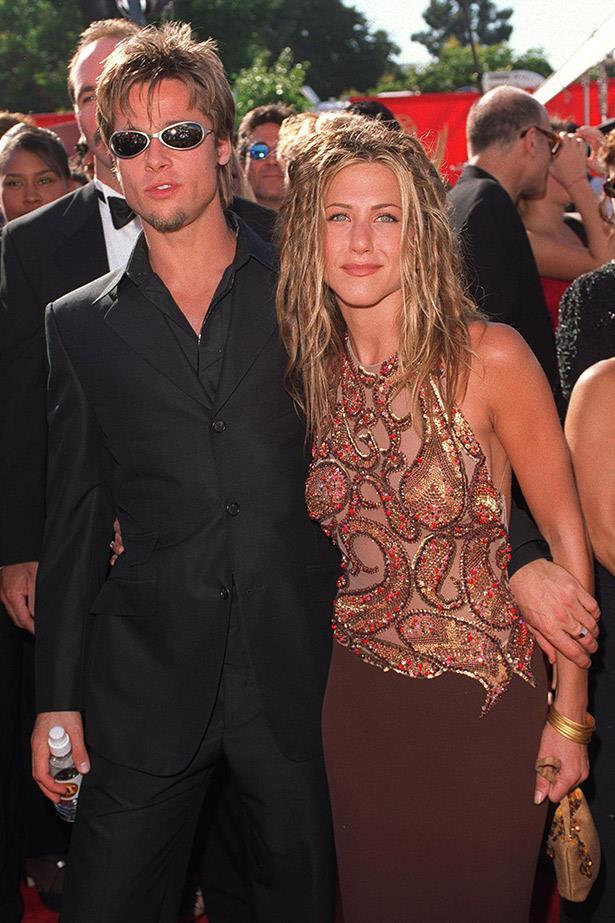 Jennifer Aniston with late-90s dreads in 1999 alongside ex-husband Brad Pitt.