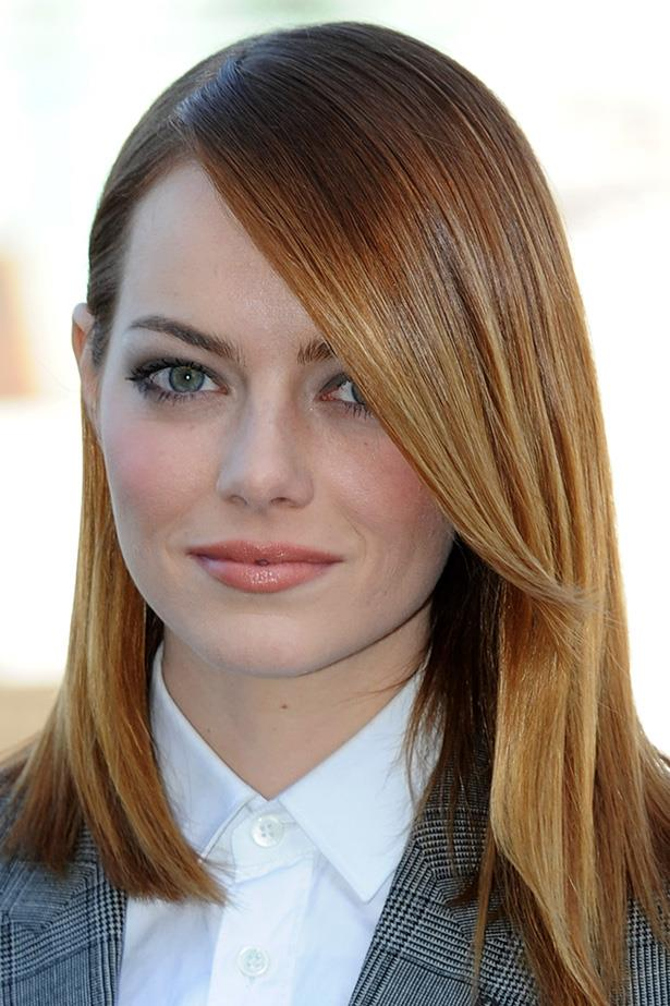 Blockbuster star, Emma Stone wears her trademark red hair short and sleek at a press event in London.