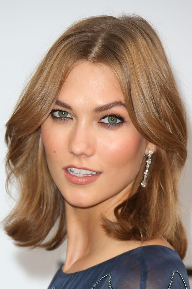 Karlie Kloss proves that Victoria Secret bounce can be achieved with a cropped 'do at the Cannes Film Festival.