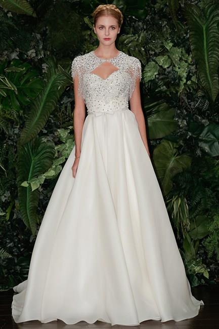 Like a princess: instead of lace, we would have welcomed Kim Kardashian dressed in embellishments. Like this Neem Khan gown from the A/W14 Bridal Collections.