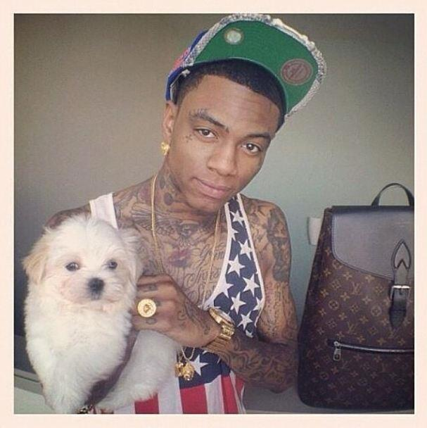 Follow @rapperswithpuppies to see more canines living the high life like Soulja Boy's sidekick.