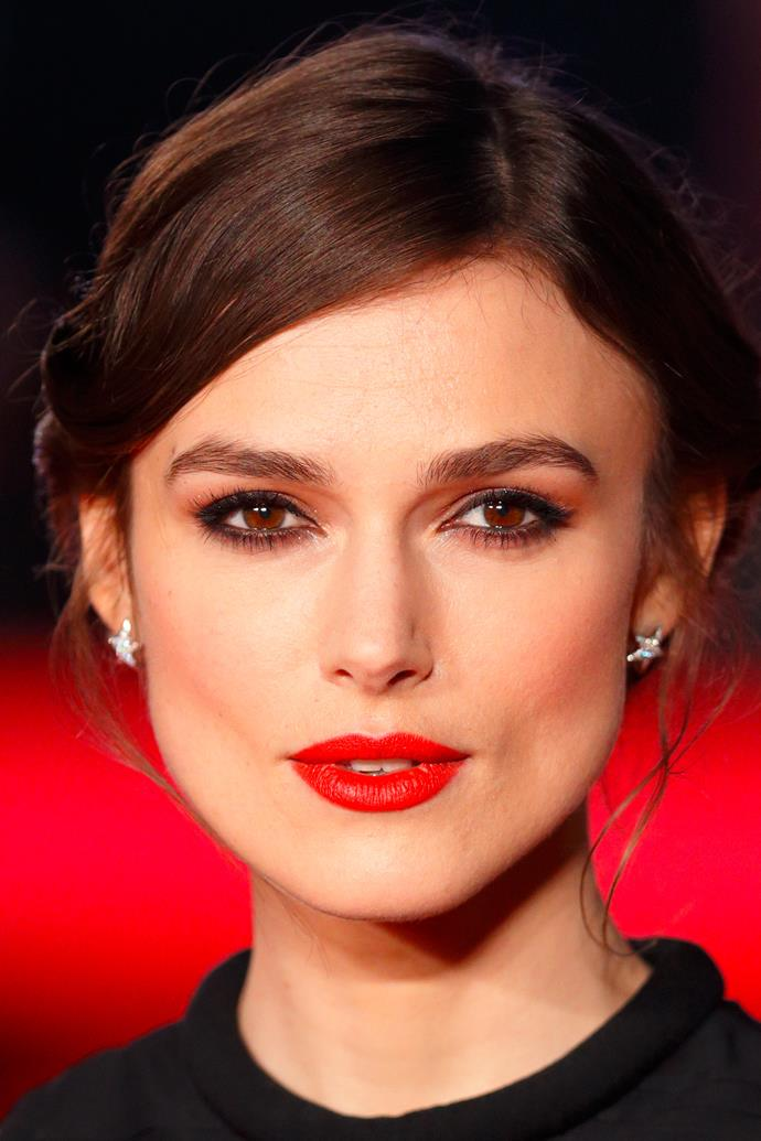A natural, thick pair balances a strong red lip on Keira Knightley at the <em>Jack Ryan: Shadow Recruit</em> premiere.