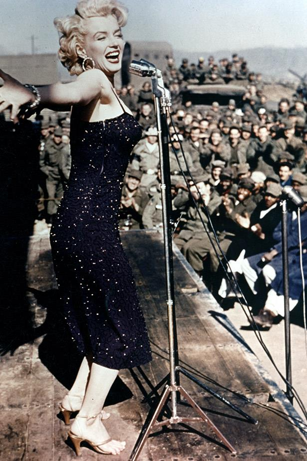 Performing for the troops. Marilyn entertains the officers stationed in Korea in 1954.