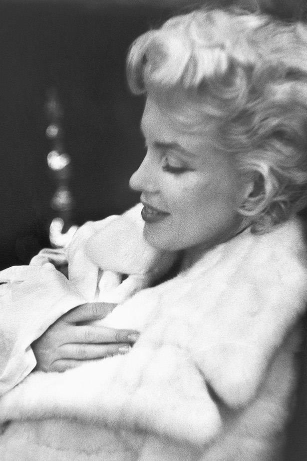 A rare off-duty shot of an exhausted Marilyn Monroe in 1955.