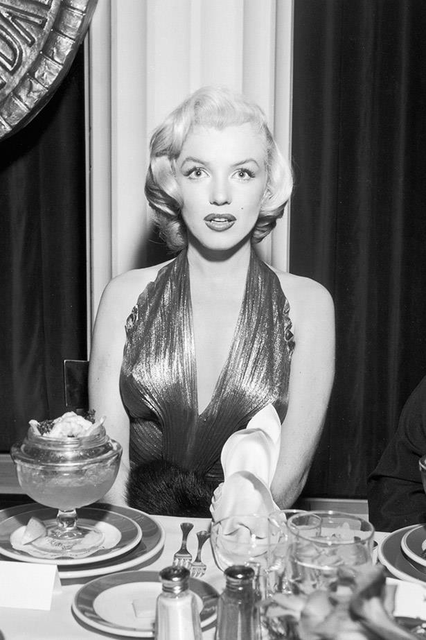 A beautiful, but stunned-looking Marilyn Monroe sits at the Photoplay Gold Medal Awards in 1953, where she won Most Popular Female Star.