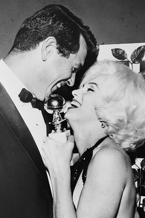 Marilyn Monroe laughs with actor Rock Hudson at the Golden Globe awards, just months before her death.