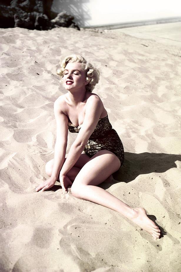 Still a rising star, Marilyn Monroe poses on a fake beach in the 20th Century Fox backlot in 1951.
