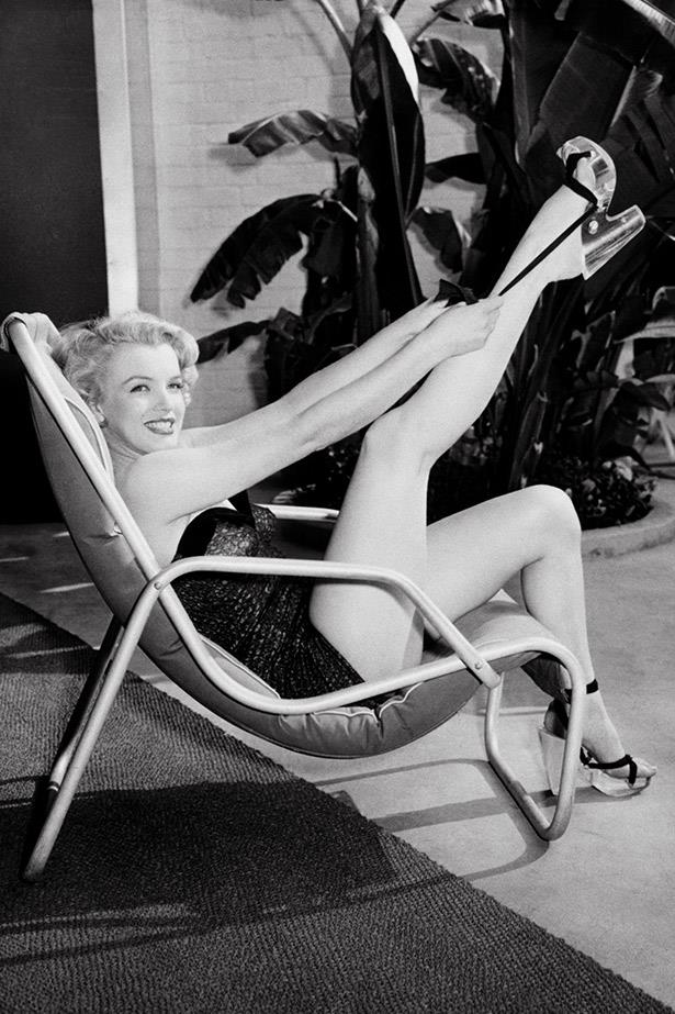 Marilyn kicks back at another swimsuit shoot in 1951.