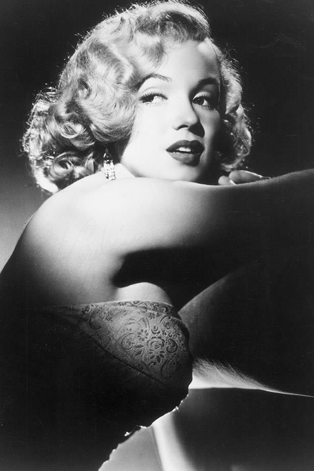 Screen siren Marilyn poses for her studio headshot in 1950. Just beautiful.