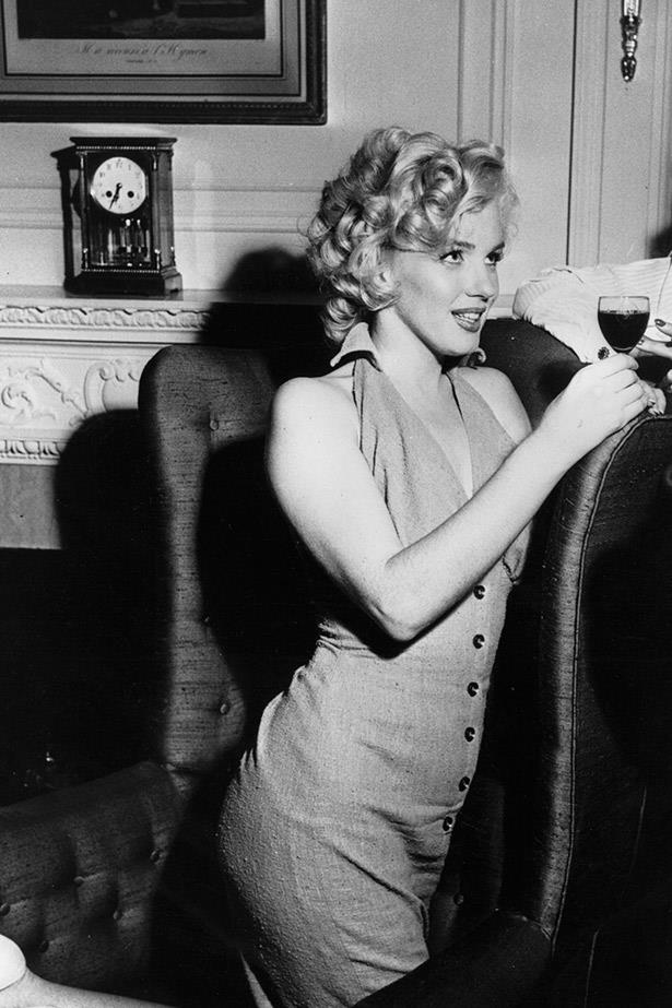 A candid shot of Marilyn socialising at a small party in the mid-50s.